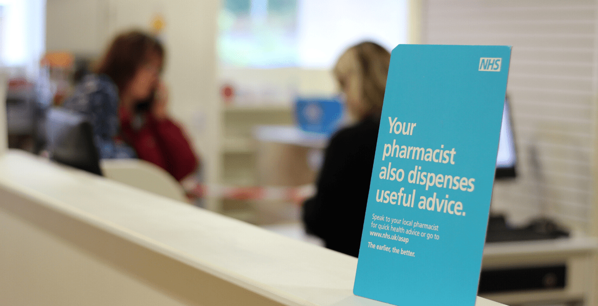 Promotional NHS sign on a pharmacy counter