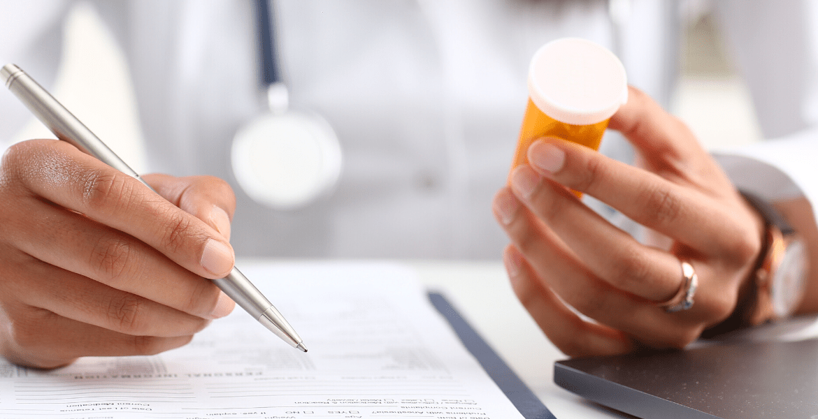 Doctor writing about medicine