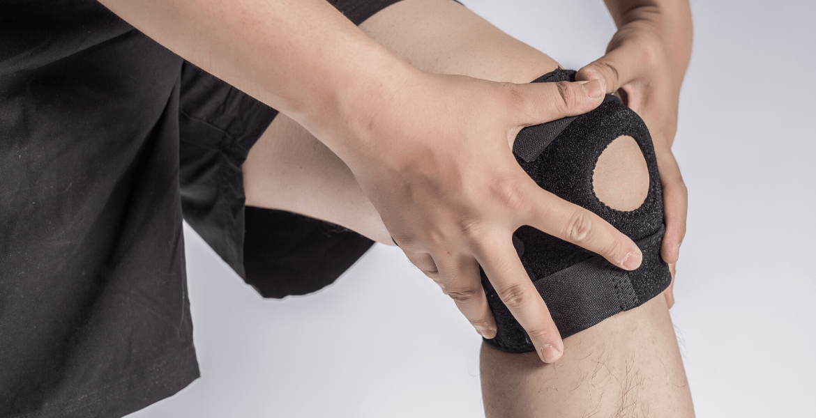 Person holding knee support