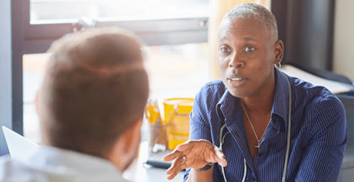 Healthcare professional talking to patient