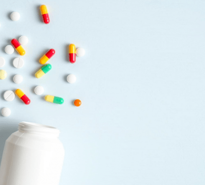 Pill bottles lying on side with pills scattered beside them