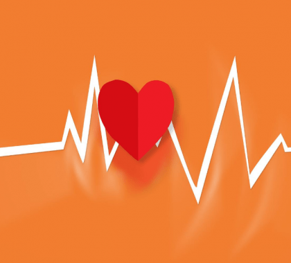 Vector heart and heart rate line against orange background