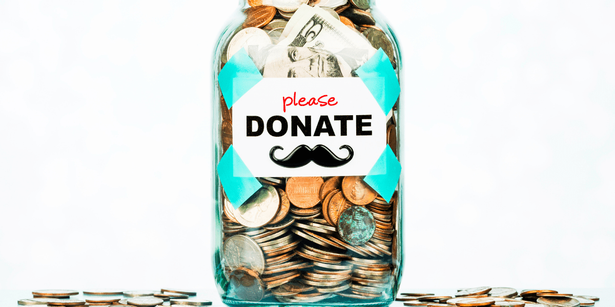 """Jar of coins labelled """"please donate"""" with a cartoon moustache"""