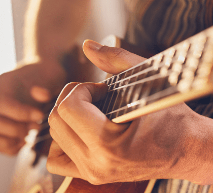 Guitar being held by hands