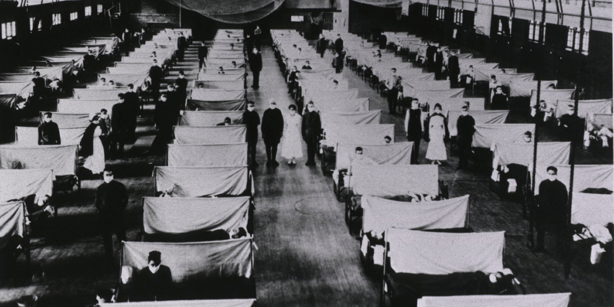 Makeshift hospital room lined with rows of patients during 1918 Spanish Flu Pandemic