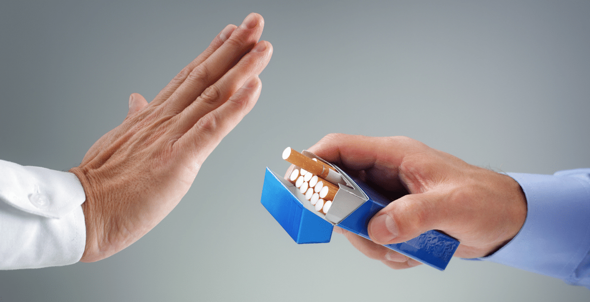 Hand rejecting packet of cigarettes