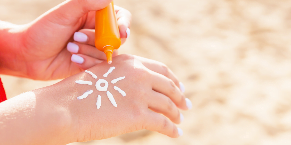 sun cream on hand in shape of sun