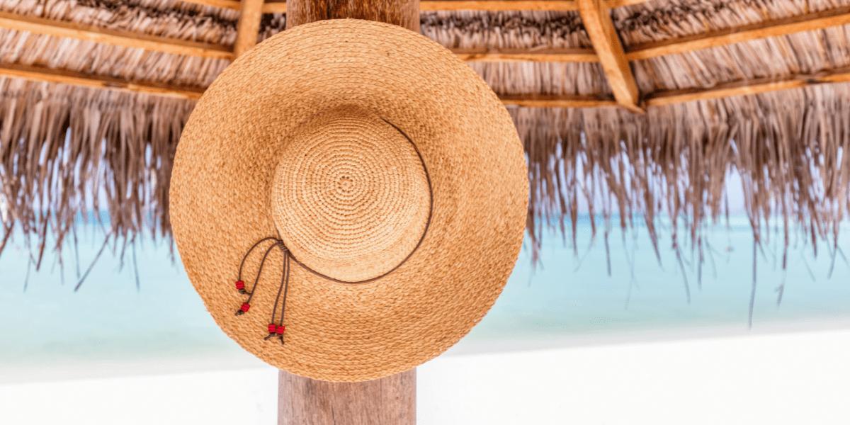 sun hat hanging on a beach